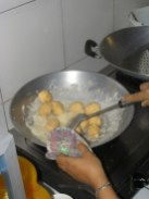 The cooked coconut balls are then coated in a palm sugar syrup