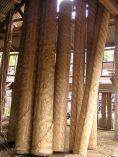Rolls of woven bamboo waiting to be sold