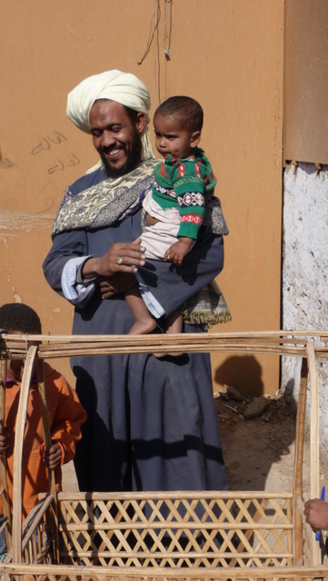 Hussein and child