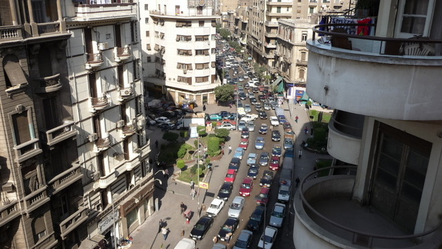 The view down Talaat Harb from my balcony at the Grand Hotel, Cairo. My semicircular balcony was similar to those pictured.