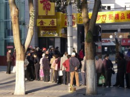 Shoppers queued up for the opening of a new shopping mall in Dunhuang