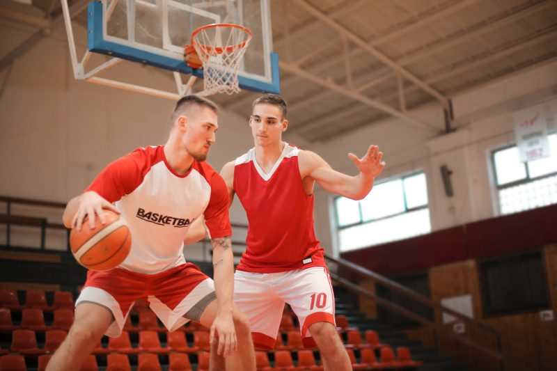 Canva - 2 Men Playing Basketball