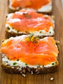 Open Smoke salmon sandwich made by Irish wheaten bread with soft cheese and Scottish smoke salmon.