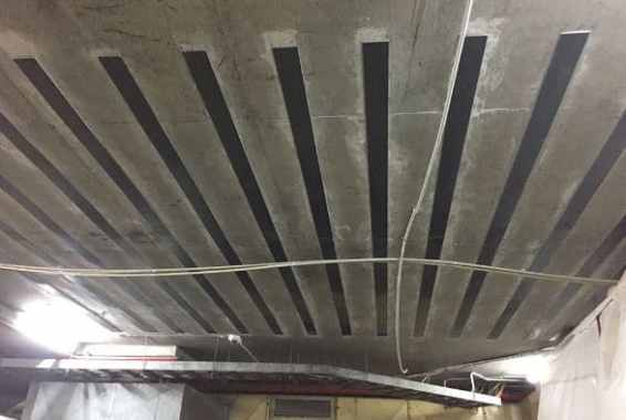 CFRP Strips Used for Strengthening of Reinforced Concrete Slab