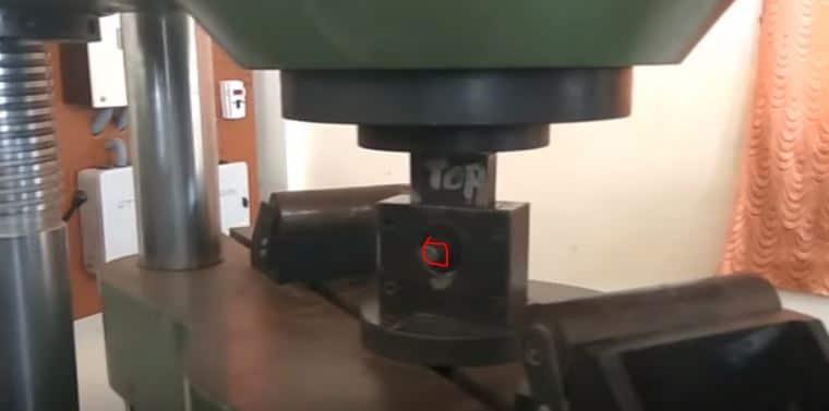 Applying Load on the Steel Rod Specimen