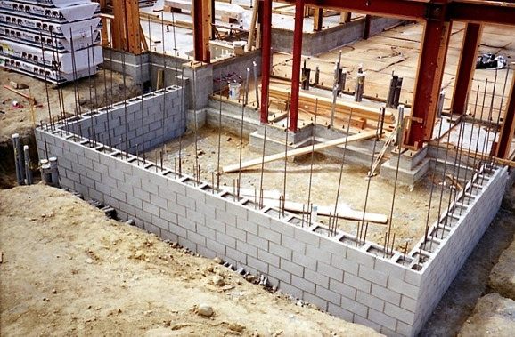 Reinforced Masonry Dry Packed Interlocing Construction