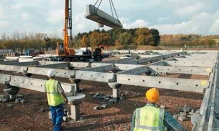 Piles Installed to Isolate Buildings from Compressive Soil