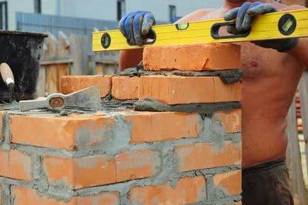 Checking level of brick masonry