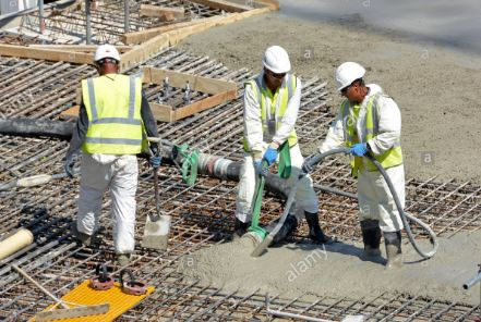 Placing and vibrating fresh concrete