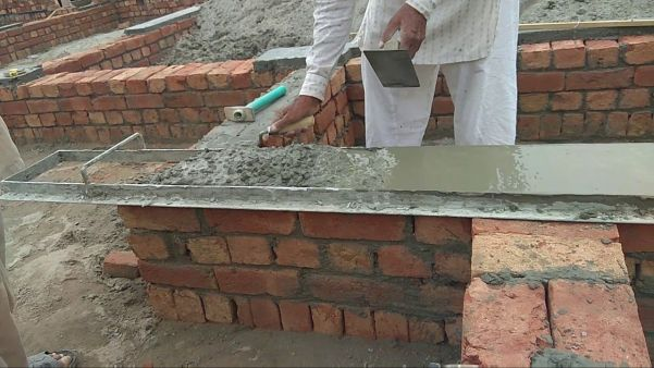 Concrete as a damp proofing material.