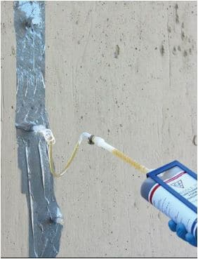 Injection of Epoxy into the Cracks through Ports
