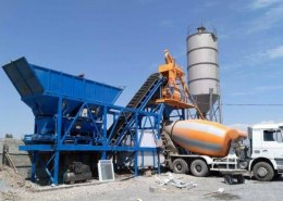 What is the most suitable volume of concrete batching plant for a transmission interconnection project?