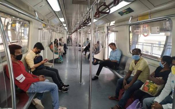 Passengers travelling during Covid-19 in Delhi Metro