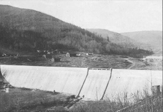 A gravity dam designed to hold back the water by its mass and friction against the foundation.