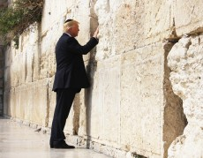 President Donald Trump places his hand on the Western Wall in Jerusalem, Monday, May 22, 2017, prior to placing a prayer in-between the stone blocks of the religious site. (Official White House Photo by Dan Hansen)