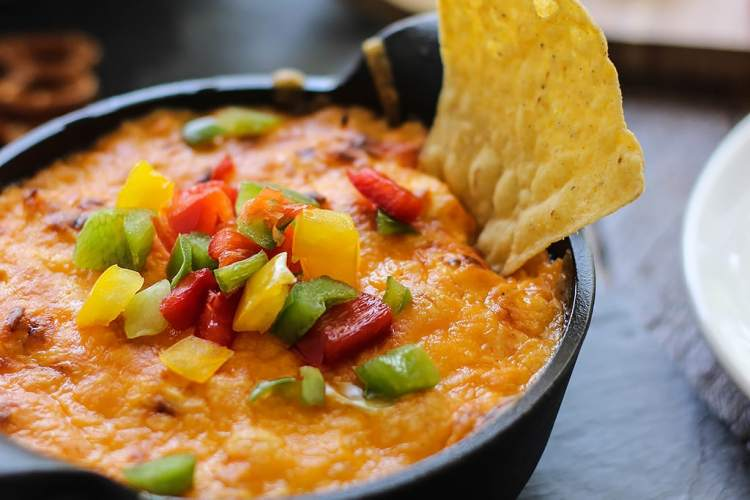 This tangy and creamy buffalo chicken dip is perfect for parties, cookouts or game day. Add some cheese to make it a bubbling dip!