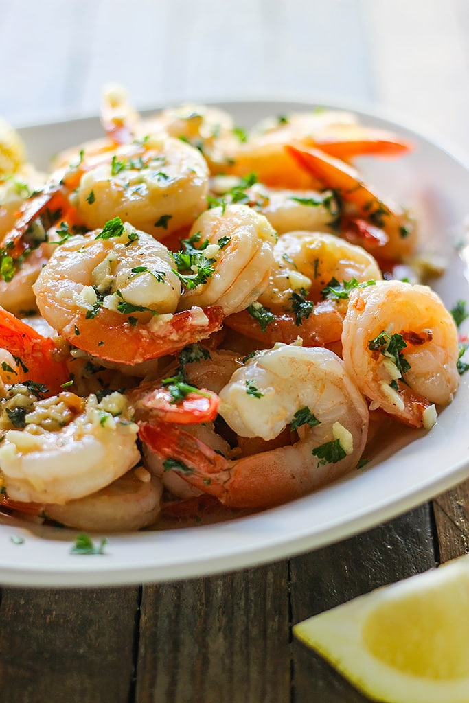 Enjoy a 20 minute meal with easy shrimp scampi; seared shrimp in a garlic buttery sauce with a hint of lemon, parsley and served over a bed of your favorite pasta.