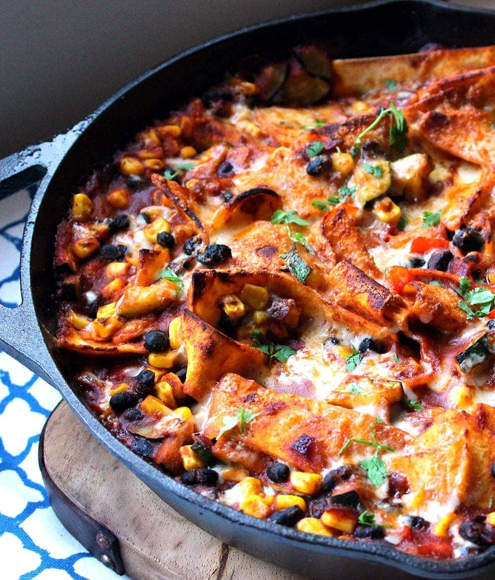This veggie enchilada skillet is super healthy and full of spicy Mexican flavours! Perfect for a weeknight dinner and great for leftovers too.