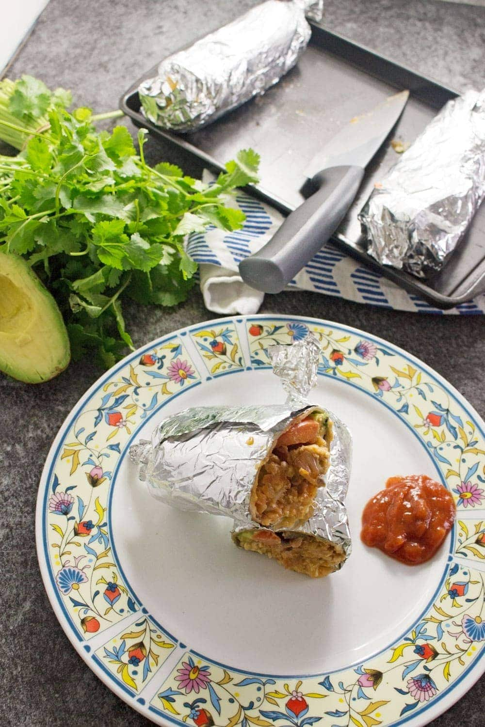 This breakfast burrito stuffed with bacon, egg and hash browns give you the perfect start to the day! They're an impressive but easy to make breakfast.