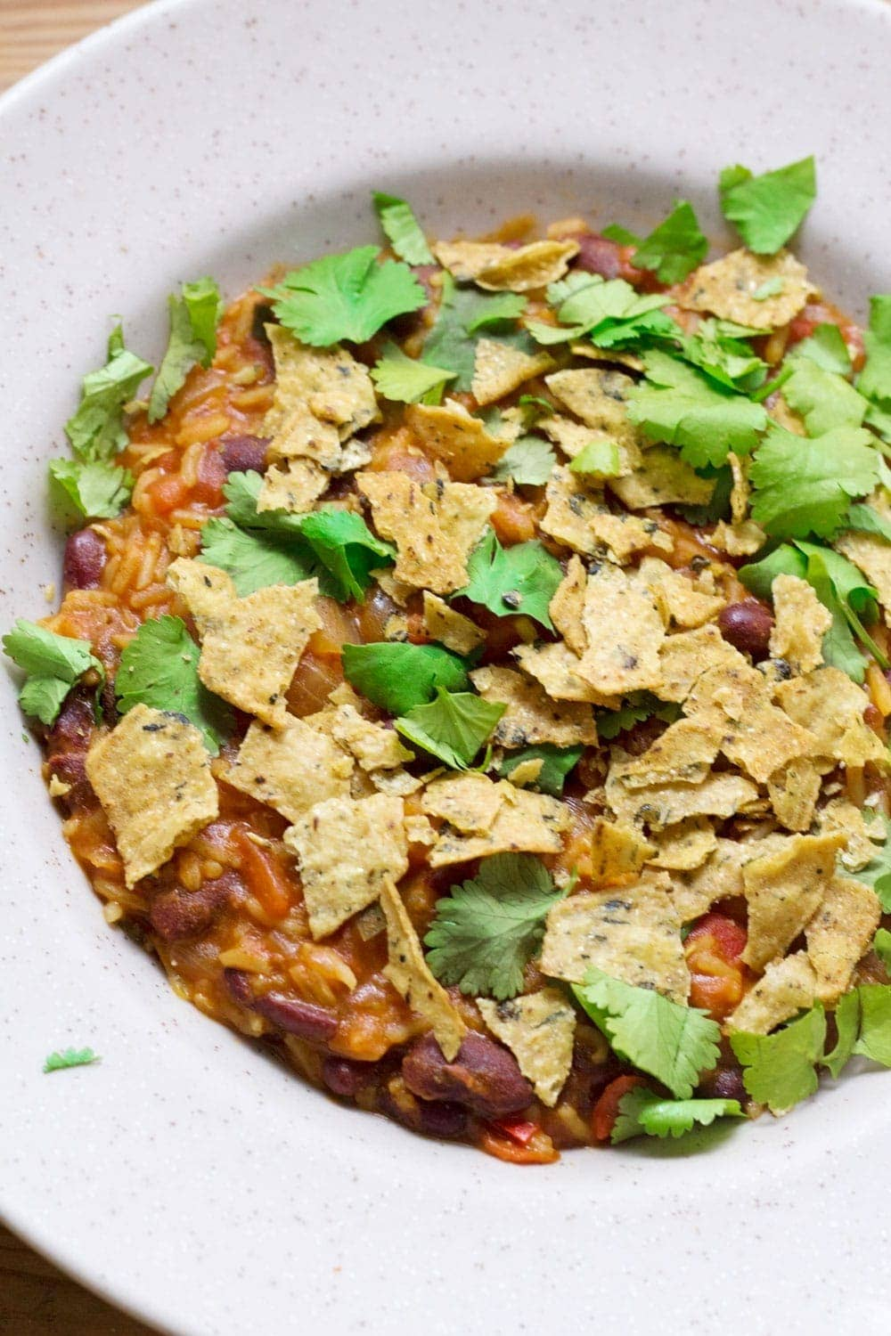 Cheesy Mexican rice and vegetable tortilla stew is a tasty vegetarian weeknight dinner packed with beans, vegetables and spices!