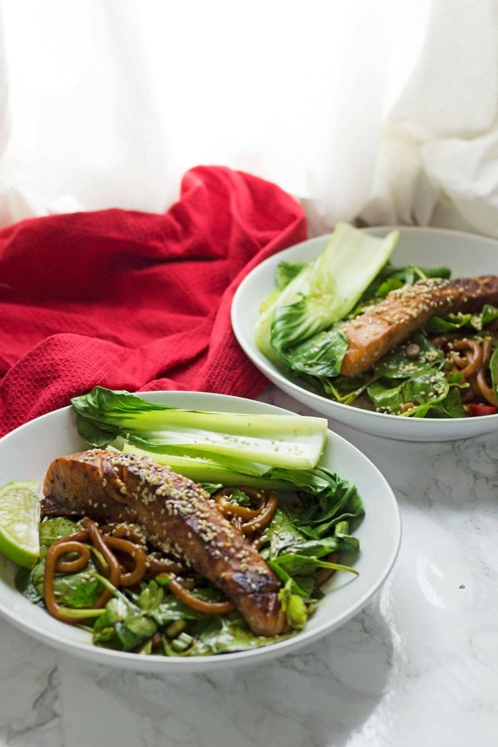This fresh and healthy teriyaki salmon with udon noodles is a delicious summer dinner with a spicy kick. Serve with spinach and pak choi.