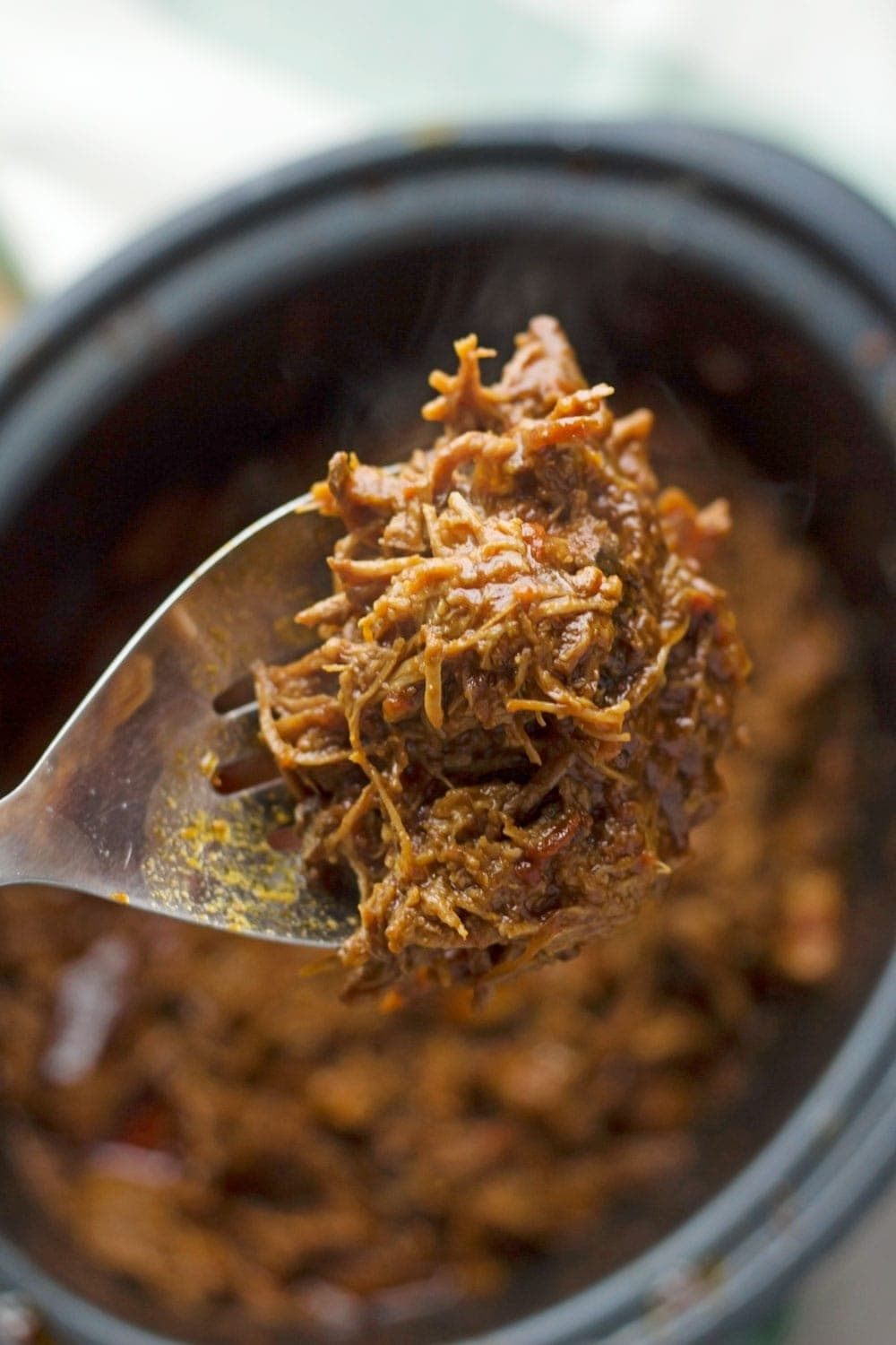 Beef brisket is slow cooked until meltingly tender for this spicy slow cooker pulled brisket. Serve in rolls or wraps for a delicious dinner!