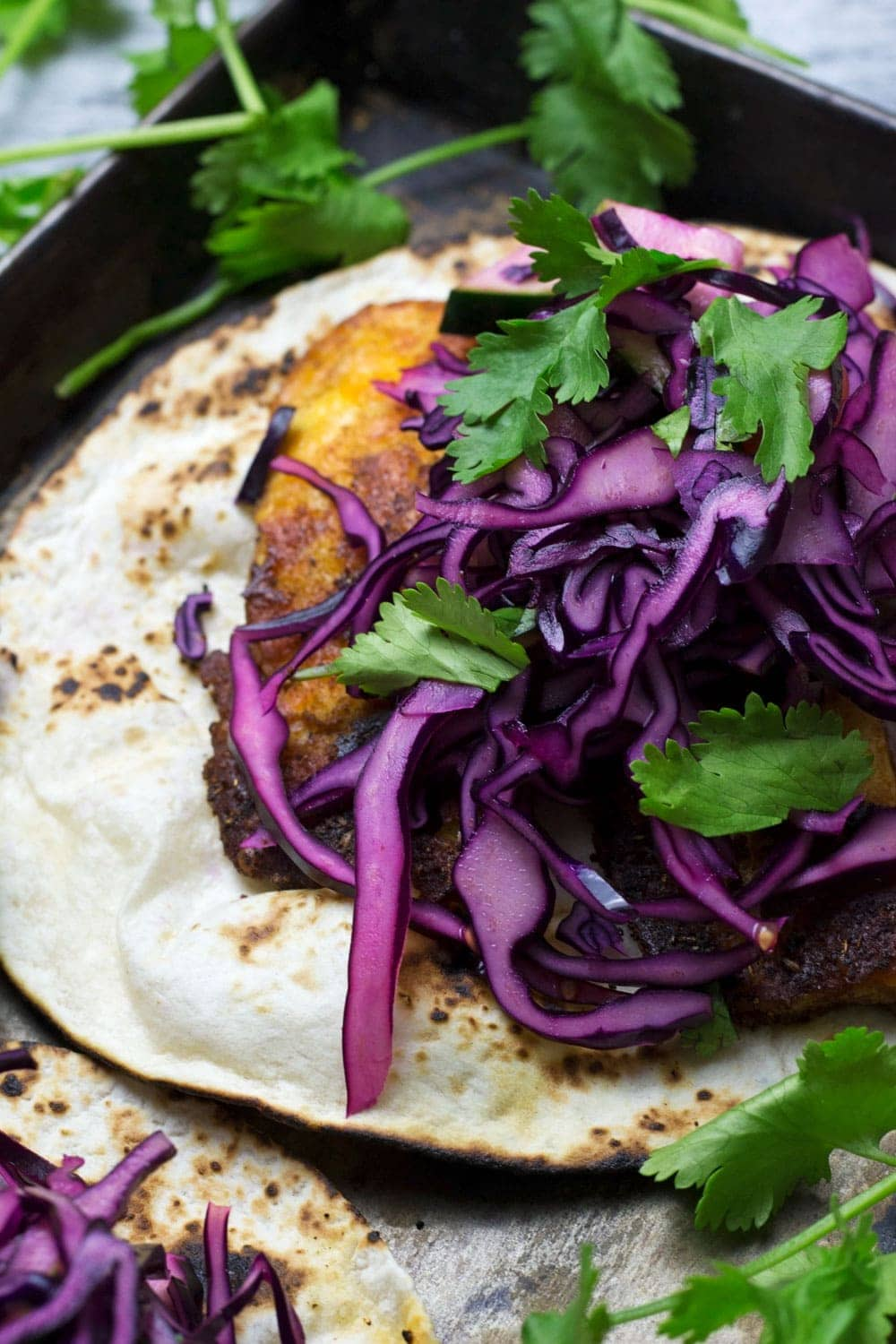These halloumi tacos are beautifully spiced and topped with a fresh and healthy cabbage slaw. An ideal vegetarian Mexican dinner!