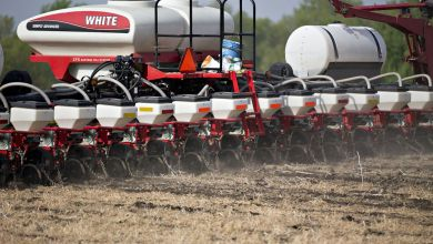 An AGCO Corp. White planter machine moves through a field as corn is planted in Princeton, Illinois.Photographer: Daniel Acker/Bloomberg