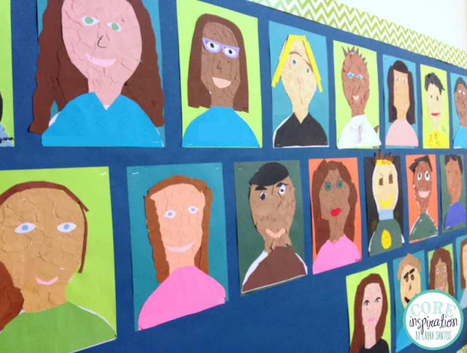 Collection of tear art self portaits on classroom bulletin board.