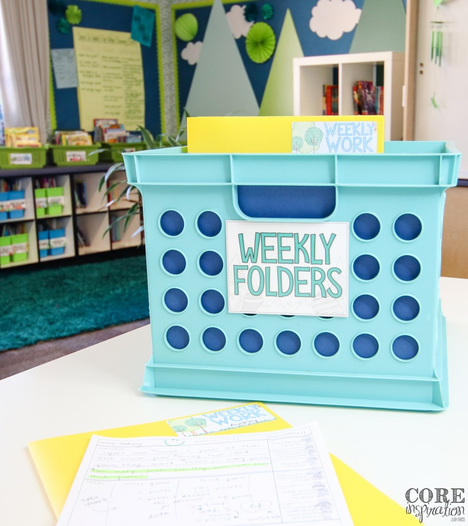 Weekly work bin in classroom with stamped paper ready to be sent home.