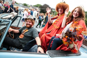 Denis Cronin driving the King of the Redheads 2015 Alan Reidy  From Blennerville, Co. Kerry and Queen of the Redheads 2015 Graine Keena from Fermoy at the Irish Redhead Convention this weekend in Crosshaven, Co. Cork. The Convention is a whacky, ginger-loving celebration of all things to do with red hair, while also raising awareness and funds for the Irish Cancer Society. Events included the crowning of the Redhead King & Queen,  gingerbread man party, carrot tossing championships, ginger speed-dating, seminars, exhibitions and much more all themed around red hair. To find out more visit redheadconvention.ie  Photo: Rory Coomey