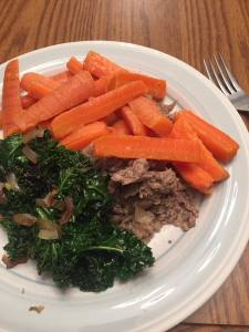 Plate of cooked carrots and kale
