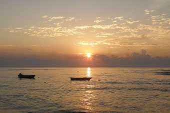 Fishing boats in the ocean near Cabuya at dawn.