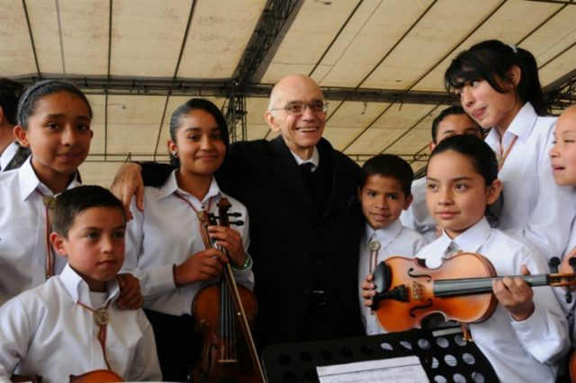 "Venezuelan director José Antonio Abreu devoted his entire life to help children and youngs to overcome poverty through musical formation within a program called ""El Sistema""."