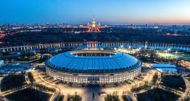 Night view of Moscow's Olympic Stadium.