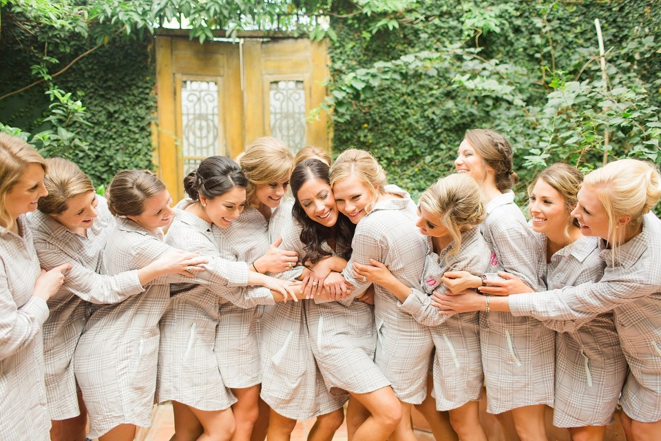 bride bridal party in robes hugging