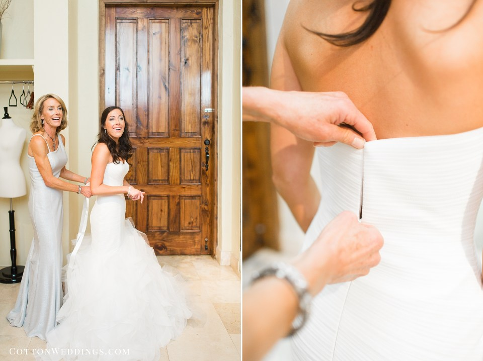 bride getting into wedding dress