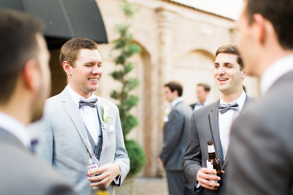 groom relaxing with groomsmen