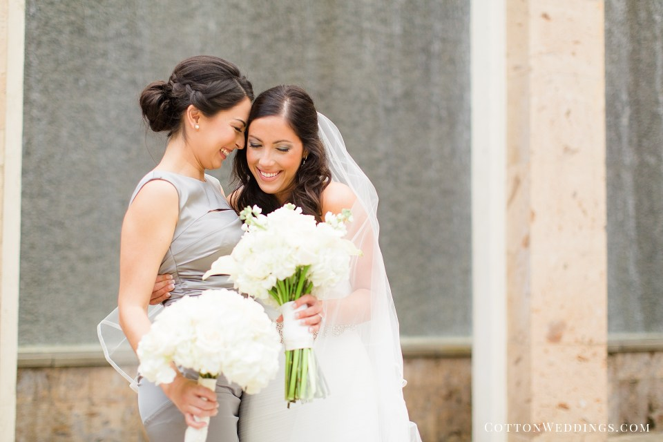 sweet photo of bride with friend hugging