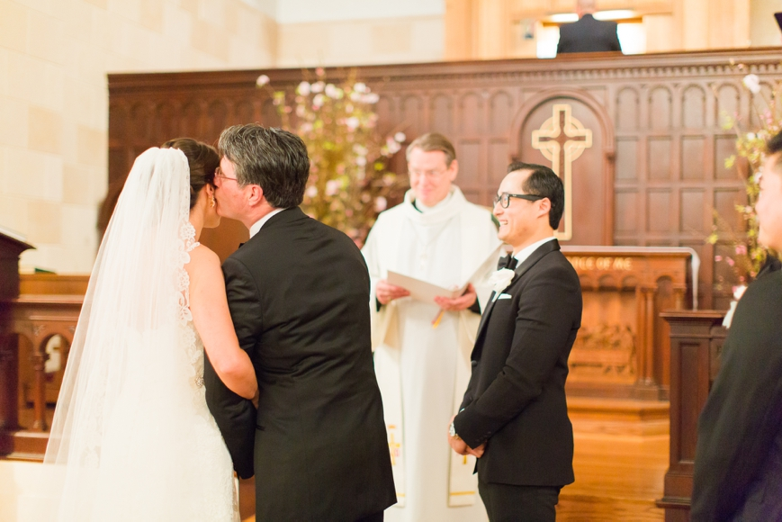 dad kissing bride on cheek to give her away