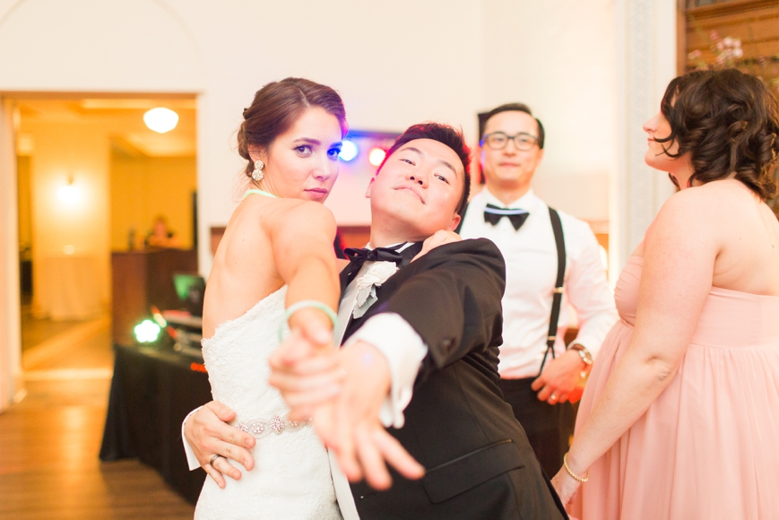 funny bride dancing with friend