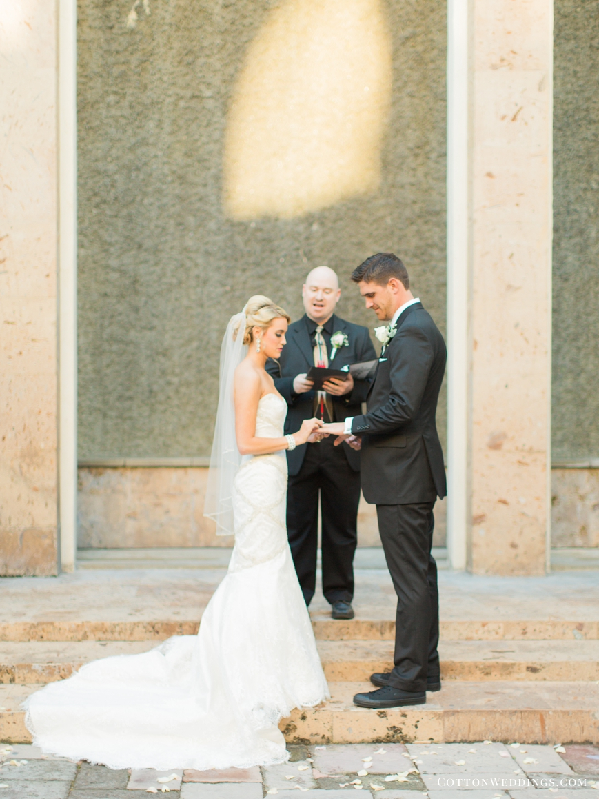 bride and groom ring exchange water wall