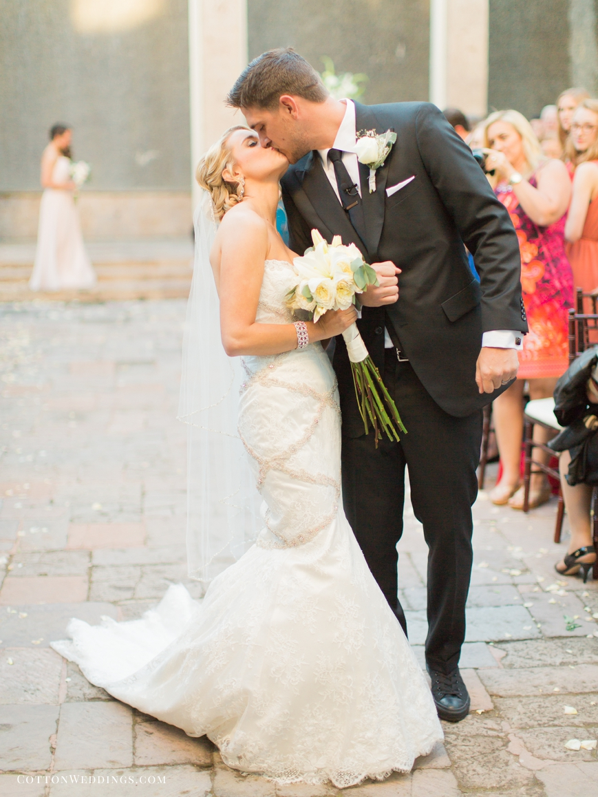 happy bride and groom kiss just married