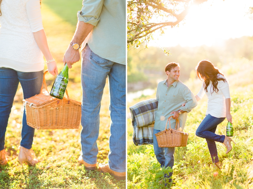 engaged couple with picnic basket and wine