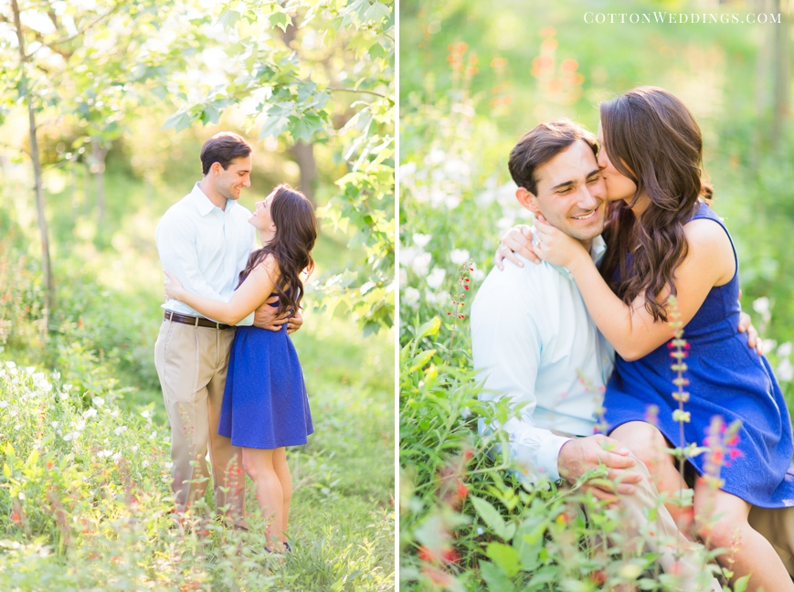engaged couple cuddling in wildflowers