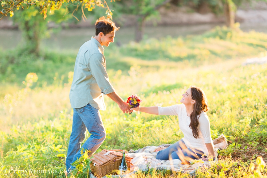 boy handing girl flowers