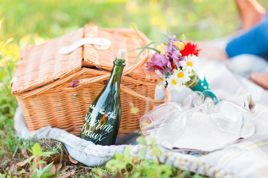 engagement session with picnic basket and flowers