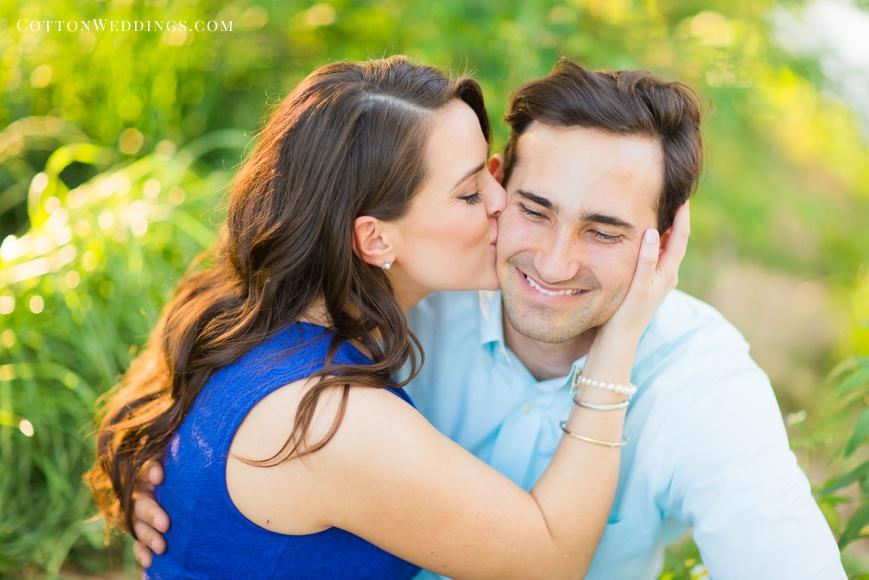 beautiful girl kissing fiance on cheek
