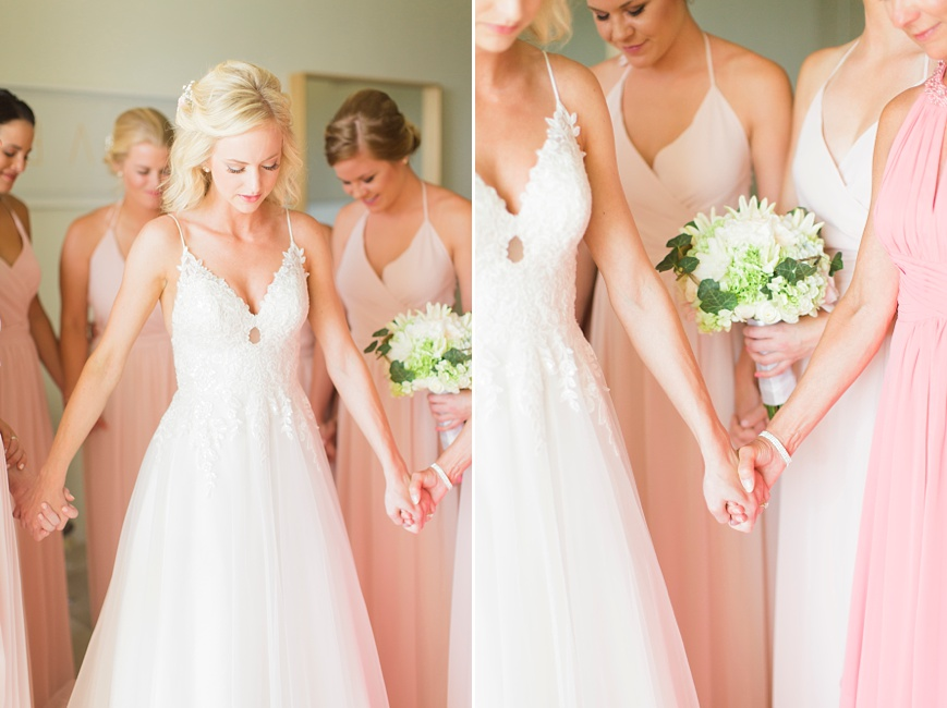 bride praying with bridal party before ceremony