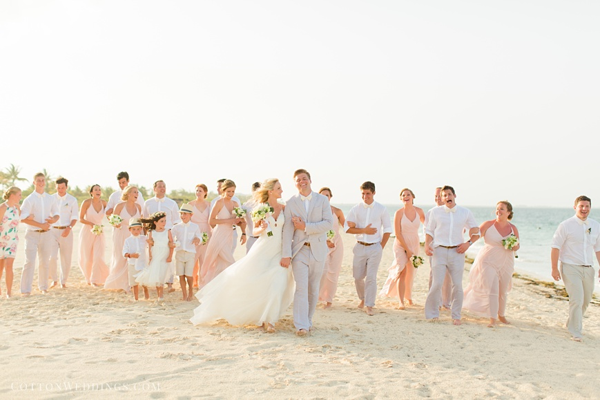 bride and groom with bridal party destination beach wedding